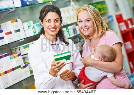 Cheerful pharmacist chemist woman giving vitamins to child girl in pharmacy drugstore poster
