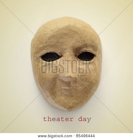 a paper mache mask and the text theater day on a beige background, with a retro effect