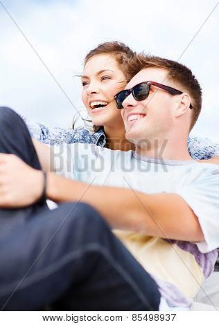 summer holidays and teenage concept - teenagers hanging out outside