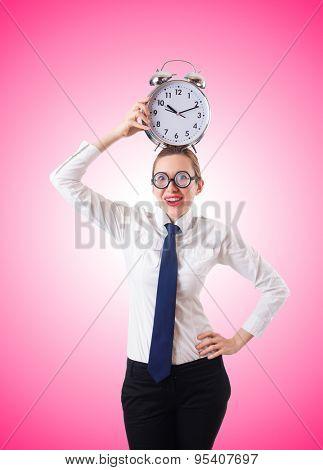 Nerd businesswoman with gian alarm clock
