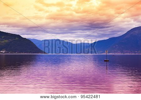 Sunset in fjord Hardanger Norway - nature and travel background poster