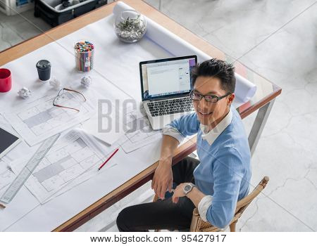 Young chineese engineer working in office