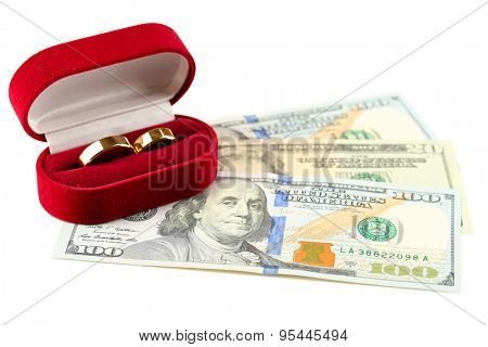 Wedding rings in box on banknotes, isolated on white background. Marriage of convenience poster