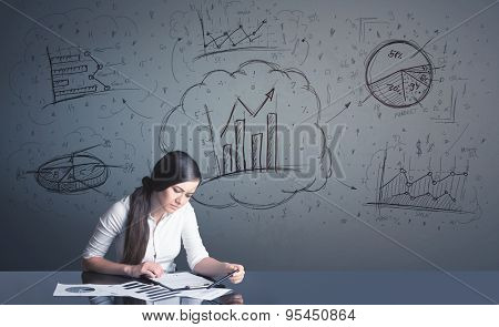 Successful businesswoman with all kind of hand-drawn business diagrams in background