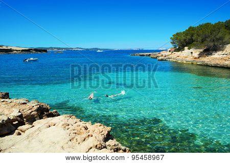 a view of the beautiful Cala Gracioneta beach in San Antonio de Portmany, in Ibiza Island, Balearic Islands, Spain