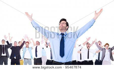Composite image of cheering businessman with his arms raised up in the air