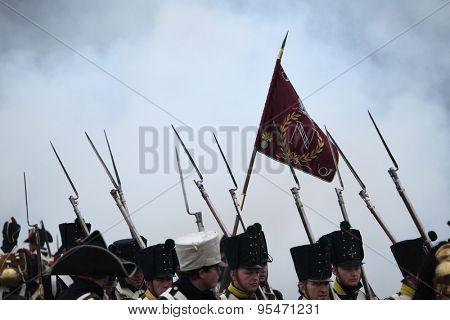 TVAROZNA, CZECH REPUBLIC â?? DECEMBER 3, 2011: Re-enactors uniformed as French soldiers attend the re-enactment of the Battle of Austerlitz (1805) near Tvarozna, Czech Republic.