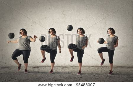 Girl training with a ball