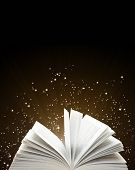 Open book and magic sparks on black background poster