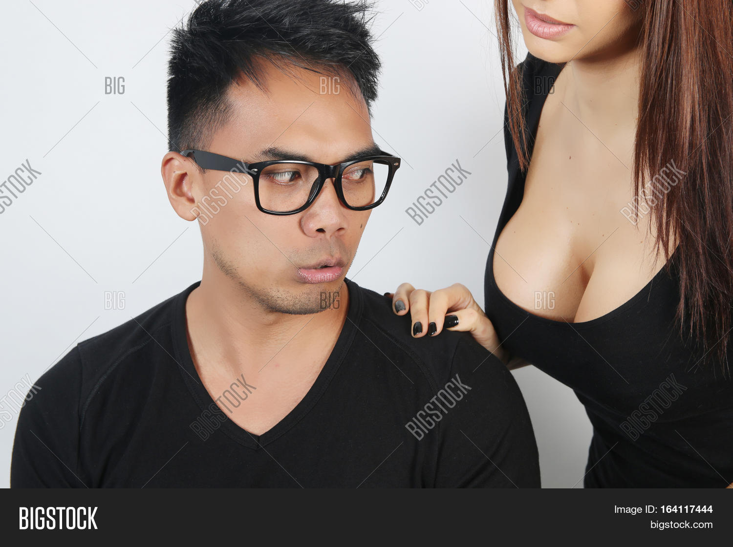 man with woman breast