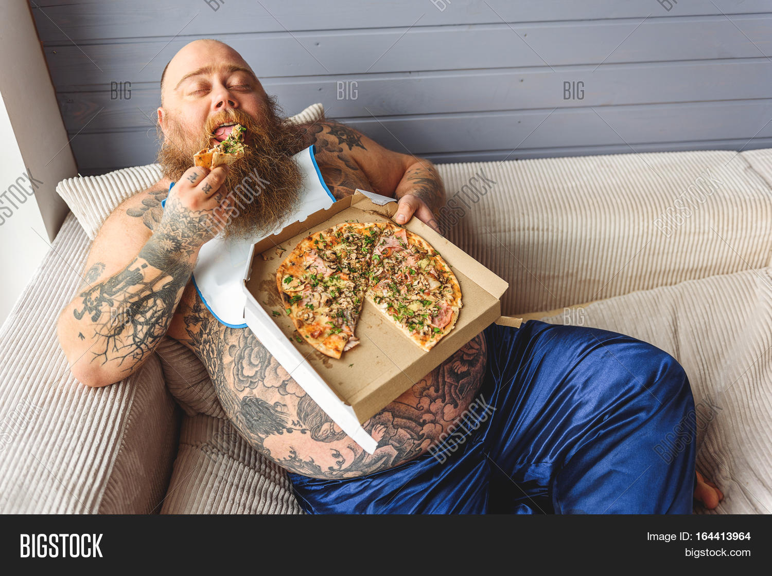 Lazy Fat Man Is Eating Pizza With Ee His Lying On Sofa Closed