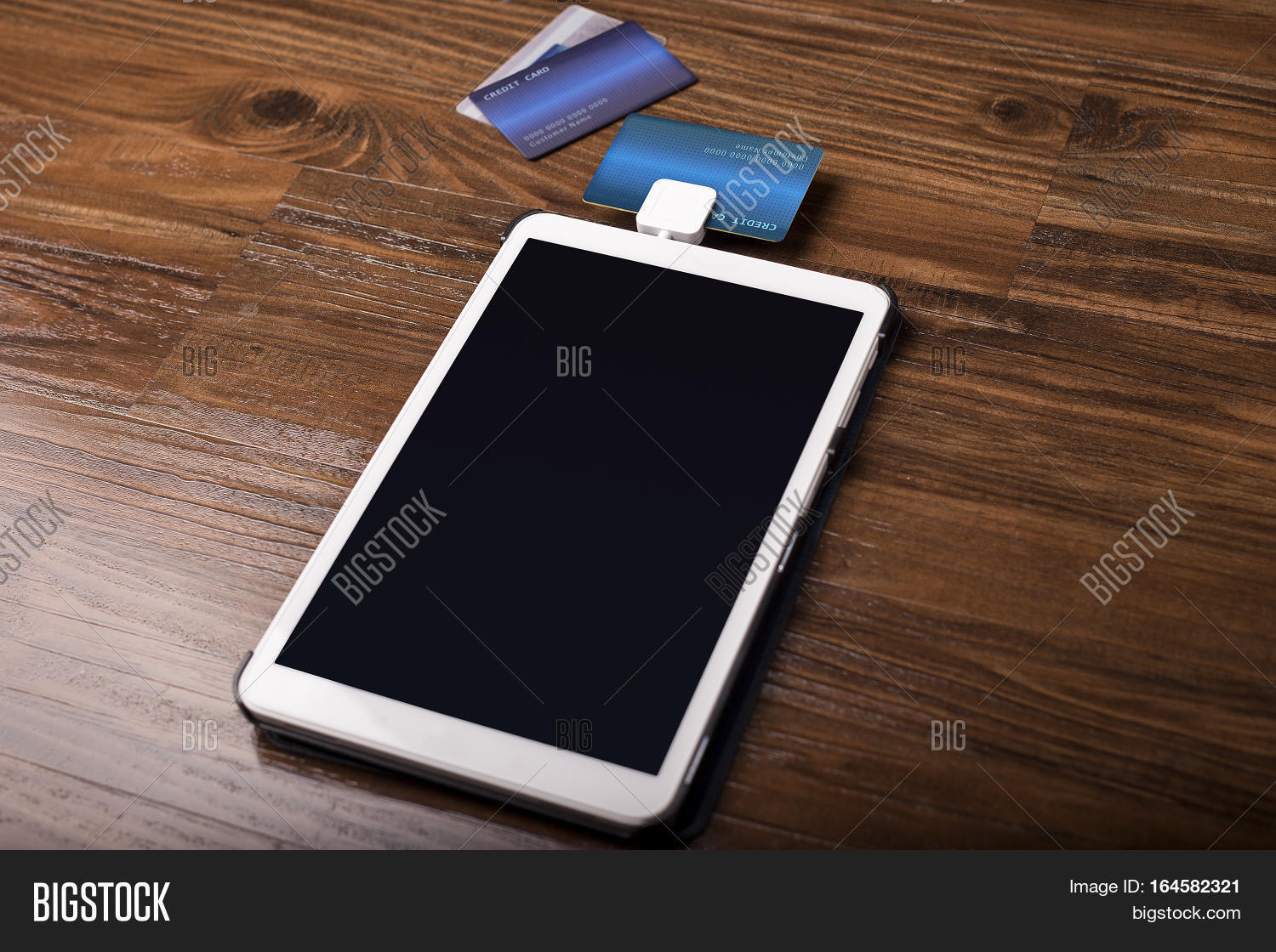 Credit card payment on image photo free trial bigstock credit card payment on a swipe or chip reader app on a tablet used by small reheart Choice Image