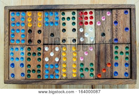 row of domino color wood in box