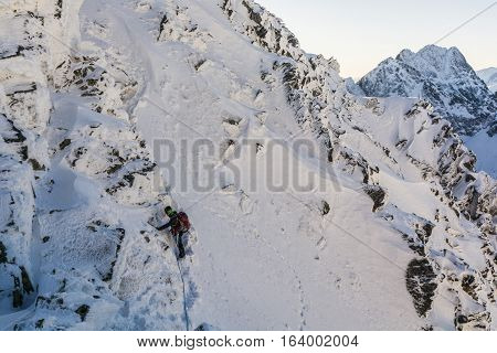Mountaineer from simul-climbing on a steep slope.