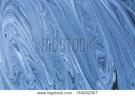 Creative ebru background with abstract acrylic painted waves. Beautiful marbling texture. Handmade marble surface. Blue and yellow colors.