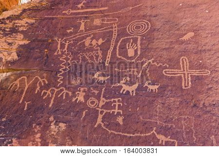 Ancient petroglyphs carved into Atlatl Rock in Nevada.