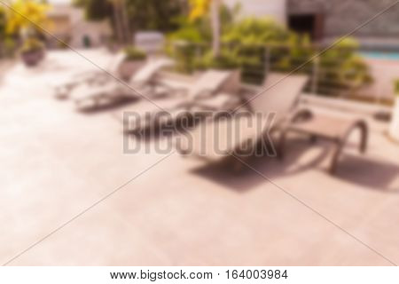 Abstract blur of sun bed on roof top of hotel and hotel sea view