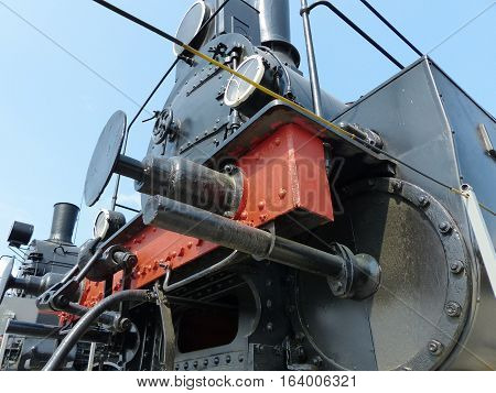 Upper Pyshma, Russia - July 2, 2016: The front part of an old steam train. Closeup. Retro. Exhibits of the Museum of military equipment.
