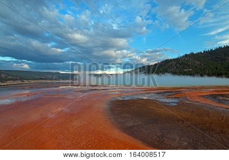The Grand Prismatic Spring At Sunset In The Midway Geyser Basin Along The Firehole River In Yellowst