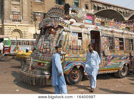 Pakistan, Karachi- NOVEMBER 14: Traditional pakistani buses, Drivers ask passengers, November 14, 2006