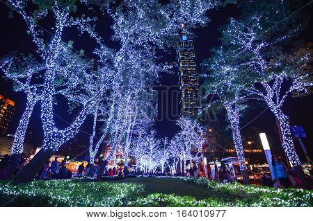 TAIPEI, TAIWAN - DECEMBER 23, 2016 - Christmas lights welcome people in the Xinyi Anhe area of Taipei, with the 101 building in the background