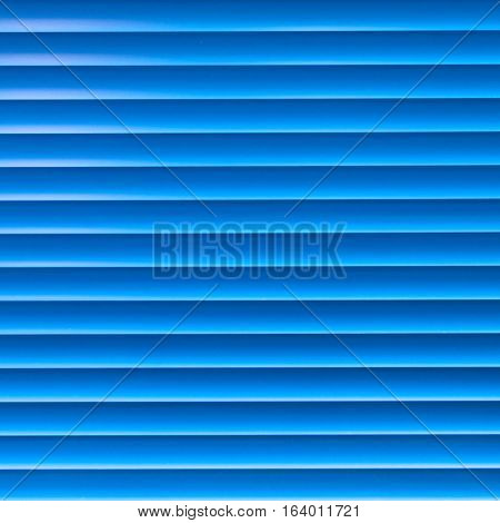 Blue horizontal Venetian blinds for background and texture.
