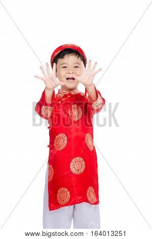 Portrait of a handsome Asian baby boy on traditional festival costume. Cute little Vietnamese boy in ao dai dress smiling.