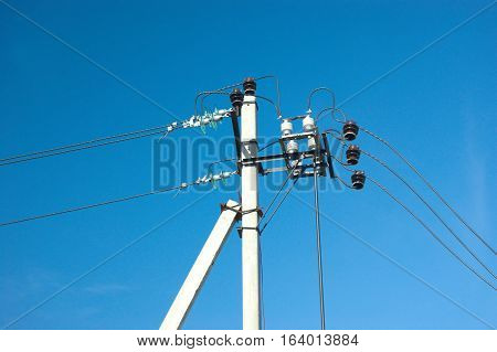 Prop of power supply line over clear cloudless blue sky
