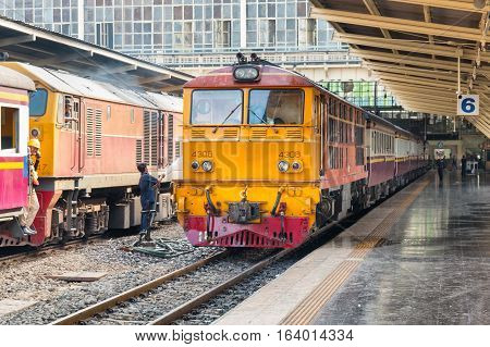 BANGKOK, THAILAND - DECEMBER 13, 2016: Trains waits at a platform of railway station Hua Lamphong in Bangkok. Hua Lamphong opened in 1916 and serves apprx 70,000 passengers and 150 trains each day.