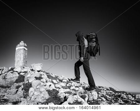 Adult Tourist With Backpack Walk On Mountain Peak. Last Step To Summit Stone