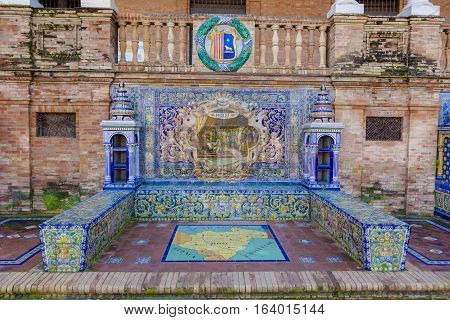 Seville, Spain - January 2, 2017: Glazed tiles bench of spanish province of Teruel at Plaza de Espana Seville Spain