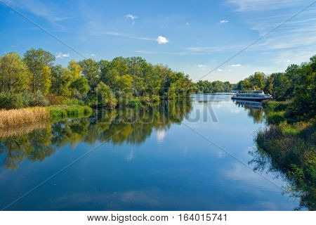 Small Ukrainian river Oril (left inflow of biggest river Dnepr) at sunny autumnal day.