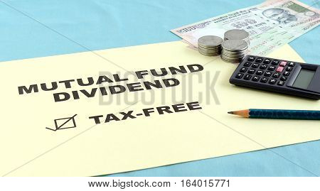 Concept that mutual fund dividend is tax free indicated with text and Indian currency.