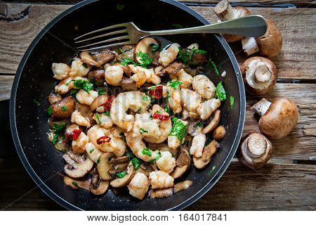 baby portobello mushroom roasted on pan with garlic