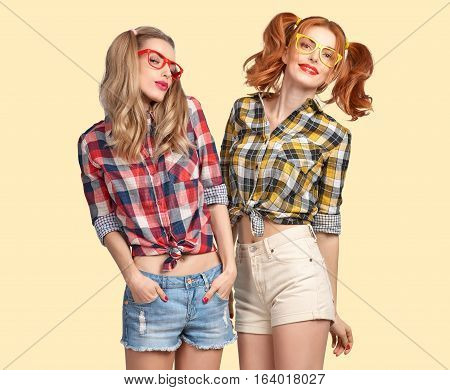 Fashion Hipster woman Having Fun Crazy Cheeky Dance. Nerd in fashion Trendy Plaid Shirt Hipster Sisters Best Friends Smile. Twins in Stylish Summer Outfit. Funny Model Girl dance, Fashion Sunglasses.