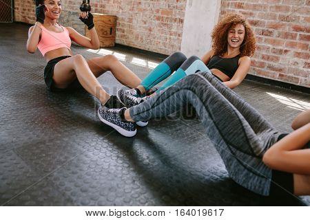 Group Of Female Exercising In Healthclub