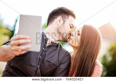 Young couple taking a selfie and having fun in the city
