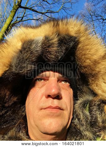 Man has fur hood on cold day