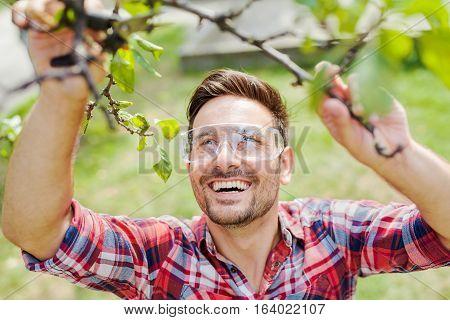 Young man gardening in his backyard close up.