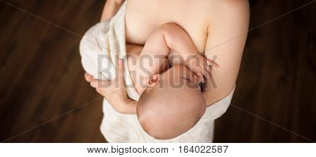 Mother is breastfeeding her baby. Close up. poster