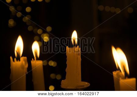 The light from the candle in the night