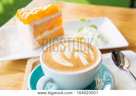 Delicious cup of coffee aromatic and delicious cakes.