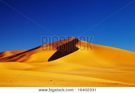 Sand dune in Sahara Desert at sunset, Tadrart, Algeria