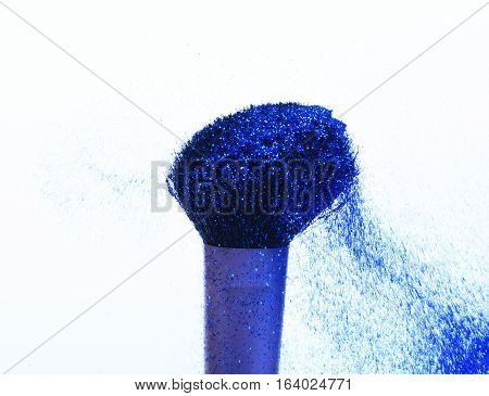 soft cosmetics brush with blue sparkle glister isolated on white copy space
