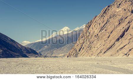 City of Jomson under snow covered peaks. Annapurna circuit trek in Nepal.