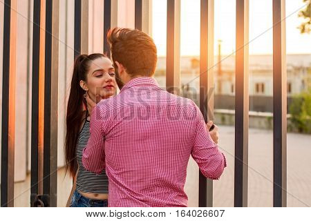Romantic couple and sunlight. Man touching woman's neck. Tender and careful.