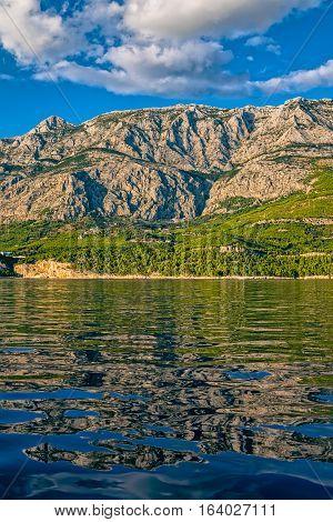 Tucepi landscape view from the boat towards the Biokovo mountain, Adriatic Sea Croatia.