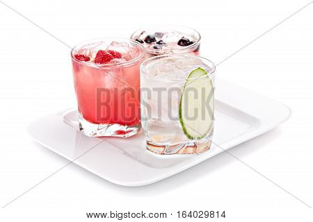Composition of the three variants of alcoholic cocktails isolated on white background.