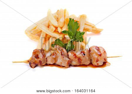 Beef skewers with french fries isolated on white background.
