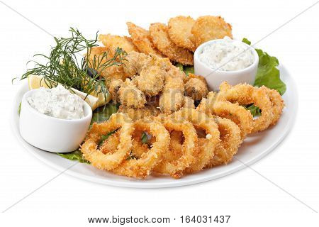 Plate of fried in batter squid and mussels with sauce isolated on white background